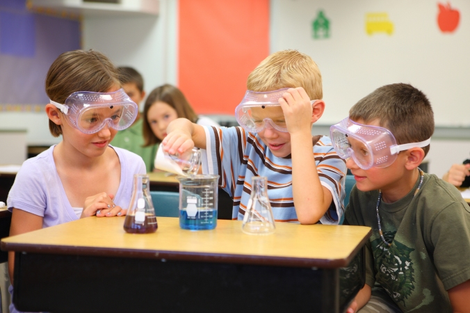 Elementary school students doing science experiment