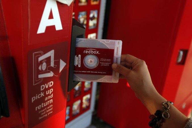 Darlene Cruz returns some DVD's at the Red Box movie rental vending machines outside Tony's Finer Foods on 4600 W. Belmont. October 6, 2009 (Phil Velasquez/Chicago Tribune) ..OUTSIDE TRIBUNE CO.- NO MAGS,  NO SALES, NO INTERNET, NO TV, CHICAGO OUT.. 00311803B REDBOX ORG XMIT: CHI0910061848406841